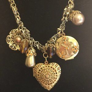 Carolee Gold tone Locket and Charm necklace